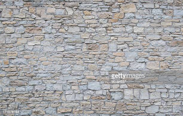 wide shot of a plain limestone wall - stone wall stock pictures, royalty-free photos & images