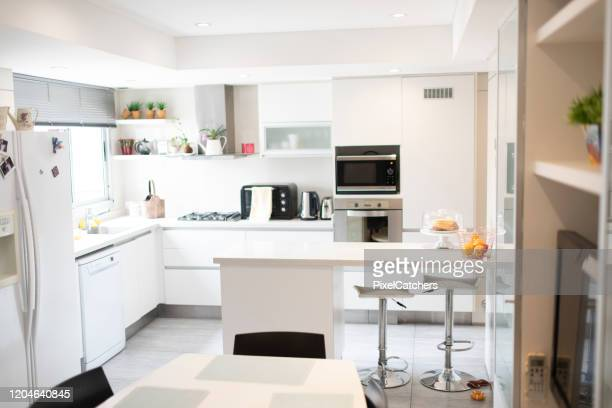 wide shot of an empty clean kitchen - wide shot stock pictures, royalty-free photos & images