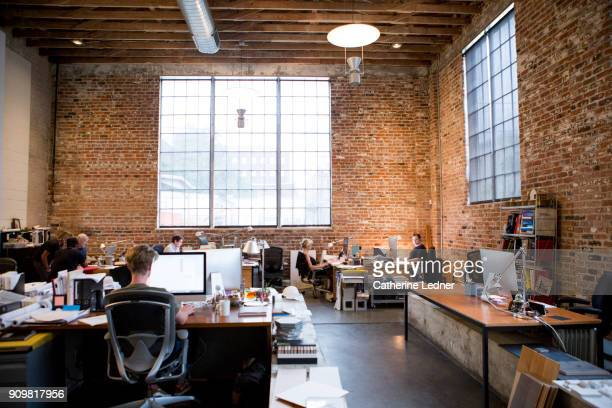 Wide Shot of Architect's Office with Brick walls and high ceilings