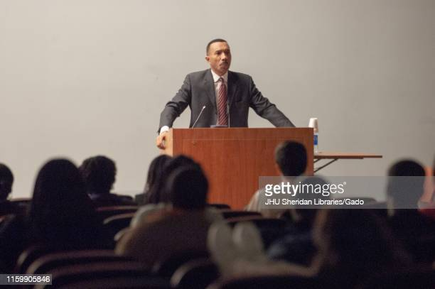 Wide shot of Kweisi Mfume politician and former President/CEO of the National Association for the Advancement of Colored People speaking from a...