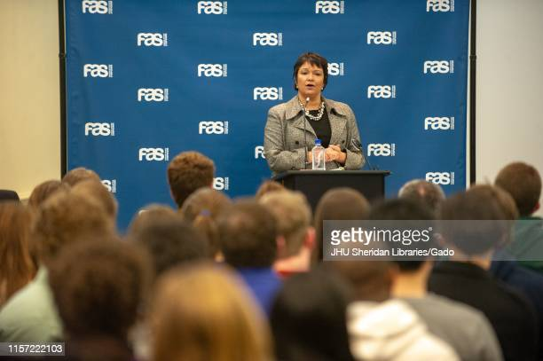 Wide shot of Lisa Jackson chemical engineer and administrator speaking from a podium during a Foreign Affairs Symposium at the Johns Hopkins...