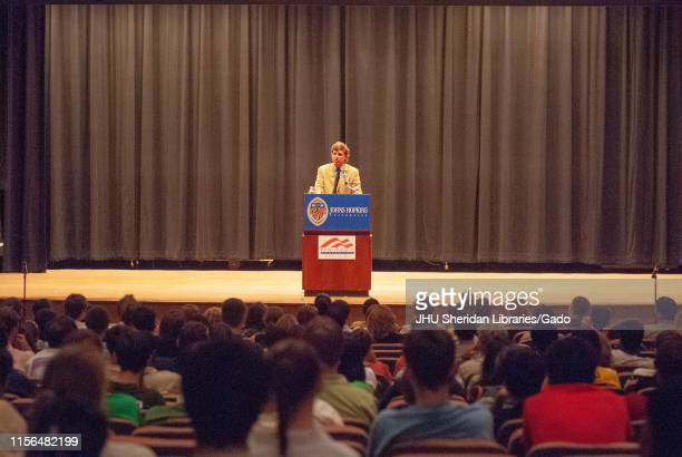 Wide shot of political commentator Tucker Carlson, speaking from a podium during a Milton S Eisenhower Symposium at the Johns Hopkins University,...