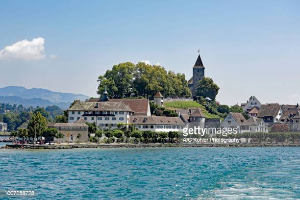 Wide shot of Rapperswil, Switzerland, from Lake Zurich with castle and monastery