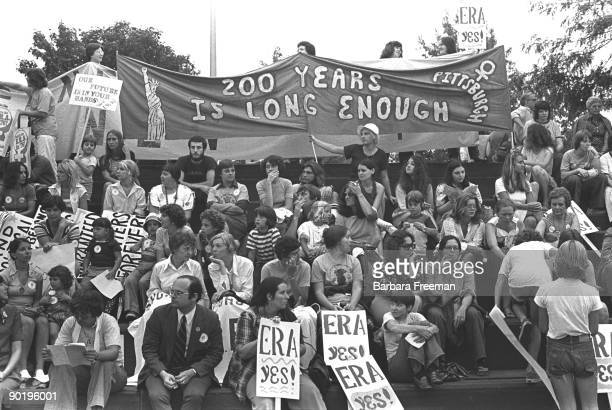 Wide shot of seated crowd at Equal Rights Amendment rally in Pittsburgh PA 1976 The banner reads 200 Years Is Long Enough