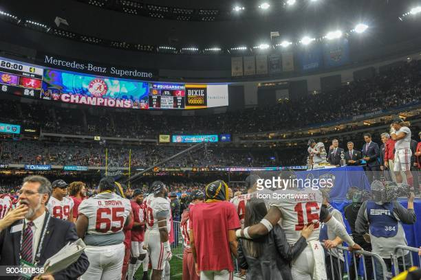 A wide shot of the MercedesBenz Superdome showing Alabama players celebrating the final score 246 following the College Football Playoff Semifinal at...