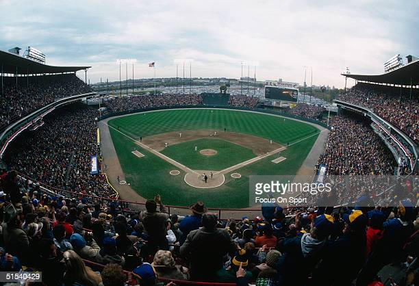 A wide shot of the Milwaukee County Stadium shows an excited crowd watching the World Series featuring the St Louis Cardinals and the Milwaukee...