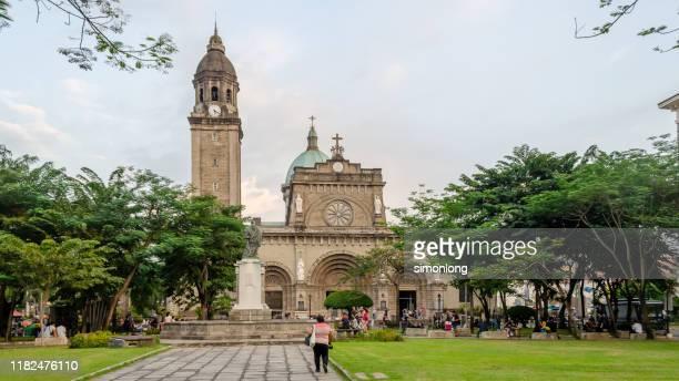 wide shot tourist visit cathedral intramuros manila, philippines - マニラ ストックフォトと画像