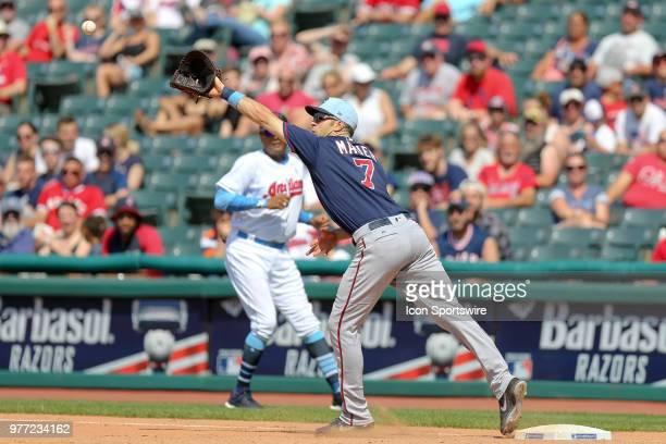 A wide throw by Minnesota Twins infielder Eduardo Escobar pulls Minnesota Twins first baseman Joe Mauer off the base for a throwing error during the...