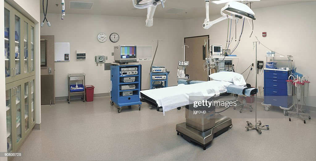 Wide View Of An Empty Operating Room With Bed And Equipment Stock