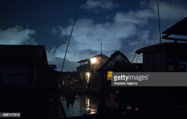A wide view of Makoko city at nightfall on April 30 2014 in Lagos Negeria Makoko is slum neighborhood located in Nigeria its population considered to...
