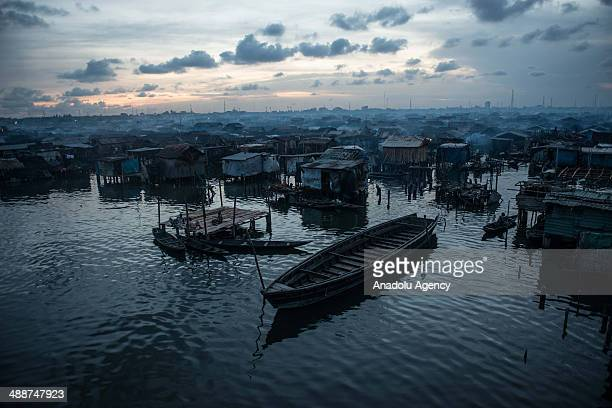 A wide view of Makoko city at nightfall on April 30 2014 in Lagos Negeria Makoko is slum neighborhood located in Nigeria its population considered to...