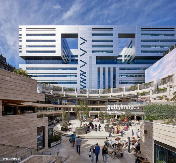 Wide View of people using the circle UBS Bank by MAKE Architects in the background Broadgate Circle London United Kingdom Architect Arup Associates...