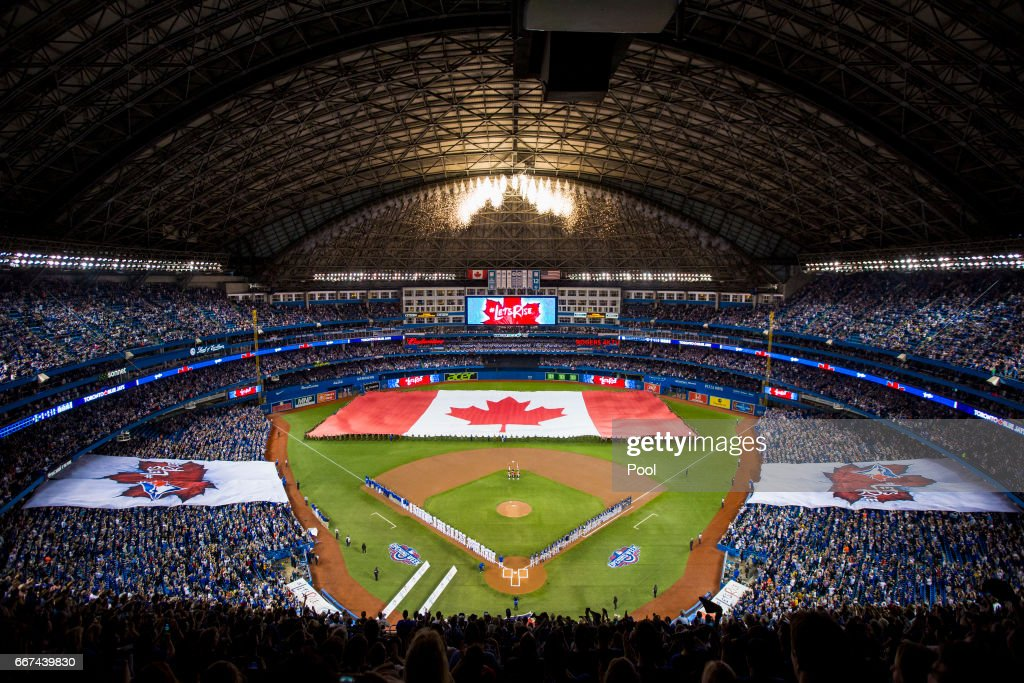 A wide view of the Canadian flag before the start of the Toronto Blue Jays home opener against the Milwaukee Brewers at Rogers Centre on April 11, 2017 in Toronto, Canada.