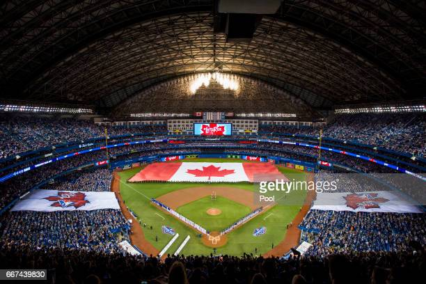 A wide view of the Canadian flag before the start of the Toronto Blue Jays home opener against the Milwaukee Brewers at Rogers Centre on April 11...
