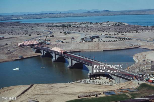 Wide view of the opening of the relocated stone arched 'new' London Bridge at Lake Havasu City in Arizona United States in 1971 The bridge links an...