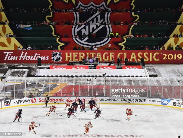 A wide view of the stadium as the Calgary Flames take on the Winnipeg Jets during the 2019 Tim Hortons NHL Heritage Classic at Mosaic Stadium on...