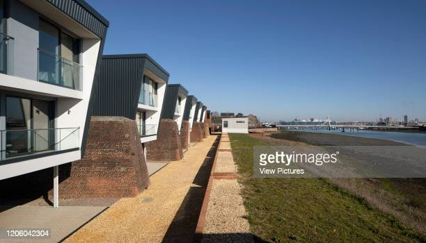 Wide view showing river and Portsmouth harbour. Priddys Hard, Gosport, United Kingdom. Architect: John Pardey Architects, 2019.
