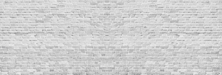 Wide white washed brick wall texture. Rough light gray vintage brickwork. Whitewashed panoramic background 1152977695