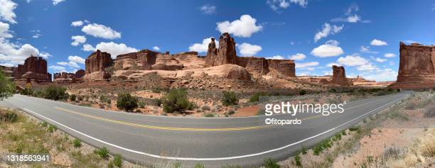 wide-angle shot in arches national park overlooking park avenue and three gossips rocks - fitopardo stock pictures, royalty-free photos & images
