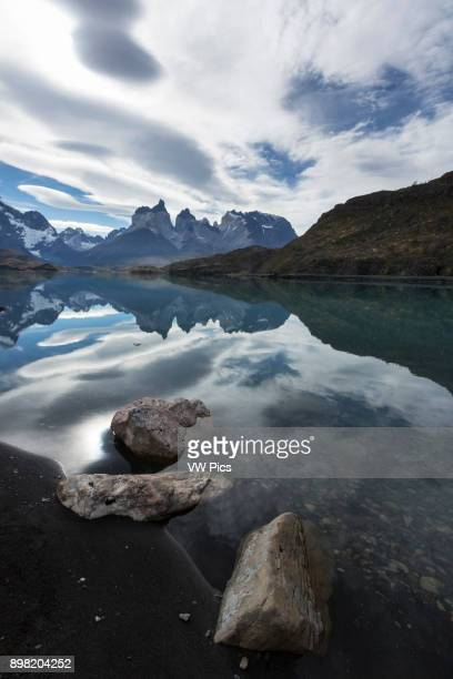 Wideangle view of the Cuernos del Paine with rocks and Lake Pehoe in the foreground Torres del Paine National Park in Patagonia Chile A UNESCO World...