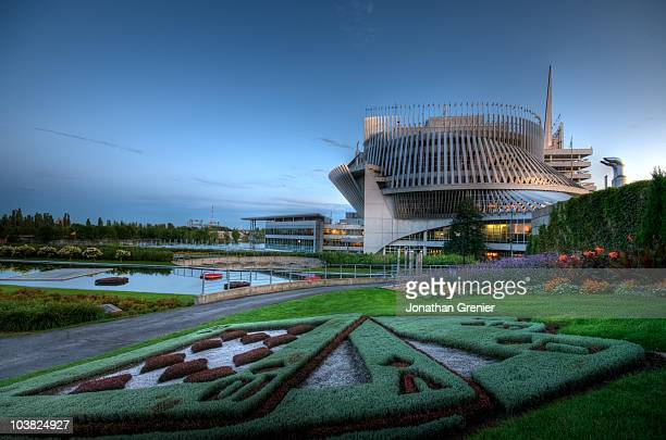 Wide-angle view of the Montreal Casino during summer with the playing cards decoration in the foreground.