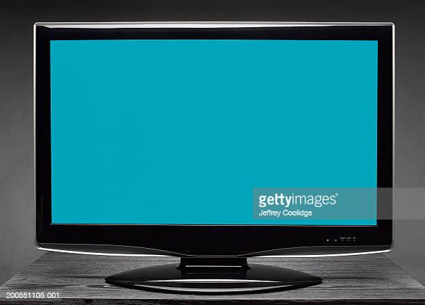 widescreen television on table - flat screen stock pictures, royalty-free photos & images