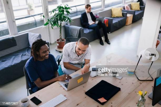 Wideshot of black businessmen working