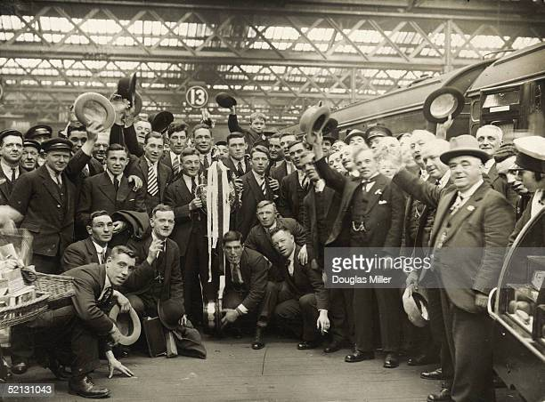 Widnes captain Paddy Douglas holding the Rugby League Cup at Euston station after their victory against St Helens 5th May 1930