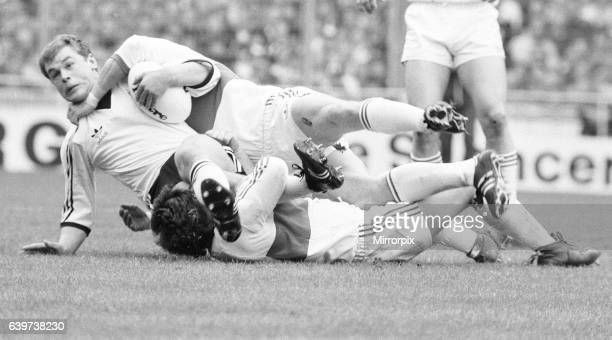 A Widnes player is brought down by a high tackle during the Rugby League Cup Final against Hull Kingston Rovers at Wembley Widnes went on to win the...