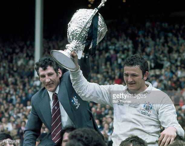 Widnes rugby league coach Vince Karalius and Doug Laughton with the Challenge Cup after their victory over Warrington in the Rugby League Challenge...