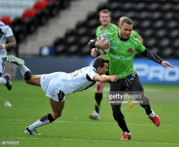 Widnes Vikings' Danny Craven holds on to Salford City Reds' Danny Williams who is dressed to avoid possible burns on the Widness pitch