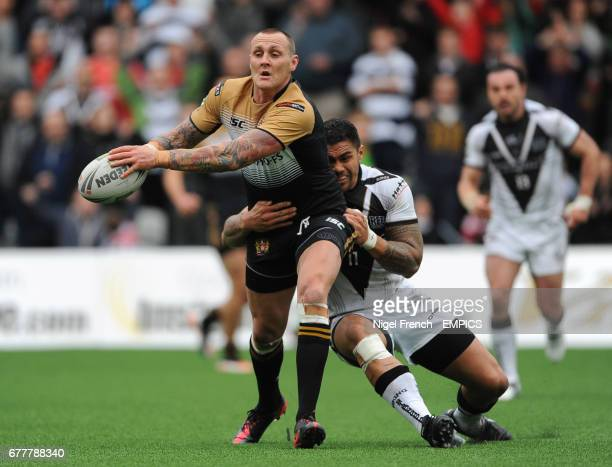 Widnes Vikings' Frank Winterstein tackles Wigan Warriors' Gareth Hock