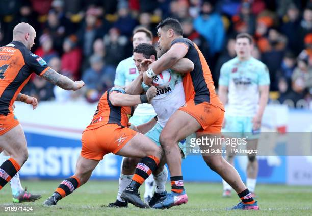 Widnes Vikings Hep Cahill is tackled by Castleford Tigers Paul McShane and Junior Moors during the Betfred Super League match at the MendAHose Jungle...