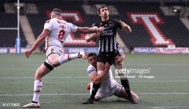 Widnes Vikings Joe Mellor is tackled by Catalans Dragons' Julian Bousquet and Remi Casty during the Betfred Super League match at The Select Security...