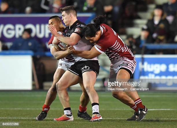 Widnes Vikings' Matt Whitley is tackled by Wigan Warriors' Liam Farrell and Willie Isa during the Betfred Super League Round 2 match between Widnes...