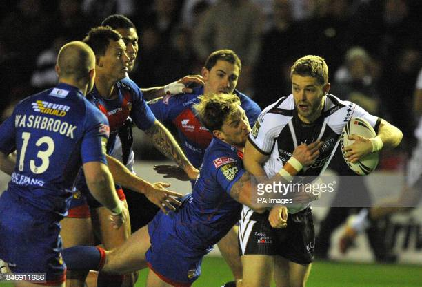 Widnes Vikings' Rhys Hanbury is tackled by Wakefield Wildcats' Danny Kirmond during the Stobart Super League match at Stobart Stadium Widnes