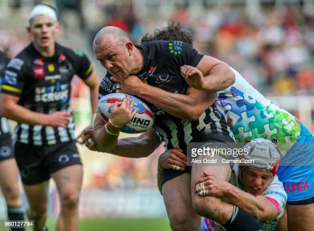 Widnes Vikings's Stefan Marsh is tackled by St Helens' Jon Wilkin and Theo Fages during the Betfred Super League Round 15 match between Wigan...