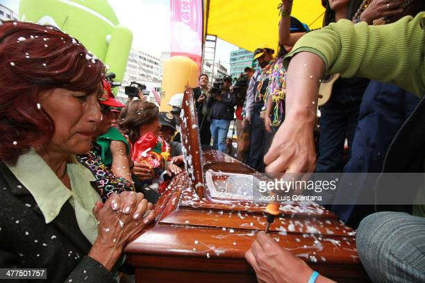 A widow cries in front of a coffin during Entierro Del Pepino fest as part of canival closing celebration on Marcha 9 2014 in La Paz Bolivia