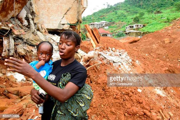 Widow Fatoumata Dioumbouya speaks to journalists about the loss of her husband on August 18 2017 in Freetown following heavy rains flooding and...