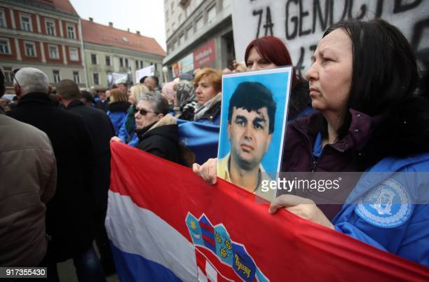 A widow holds a portrait of her husband who died in the war during a protest by widows of the soldiers of the Croatia's War of Independence and war...