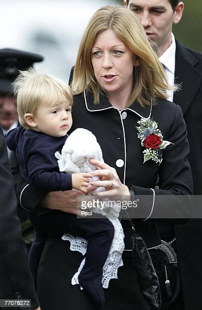 Widow Jennifer Duncan and ten month old son Jake arrive at the funeral of former quad bike champion Graeme Duncan on September 28 2007 in Edinburgh...