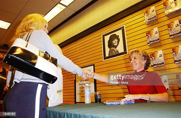 Widow Lisa Beamer greats a fan prior to signing copies of her new book Let's Roll Finding hope in the midst of crisis at Barnes Noble Westside...