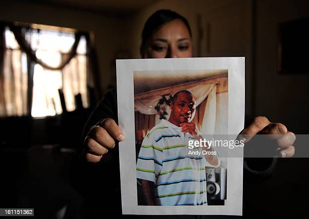 DENVER COJANUARY 12TH 2010 Widow Mariasol Gonzales holds a photograph of her husband Quincy Henderson at a friends house in Denver Tuesday afternoon...