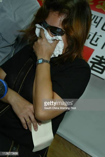 Widow of bus driver Chan Wanlin who died in Tuen Mun Bus crash on 10 July cries after receiving a cheque from the Motor Transport Workers General...
