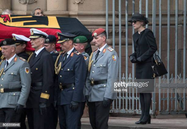 Widow of former German Chancellor Helmut Kohl Maike KohlRichter walks next to the coffin of former German Chancellor Helmut Kohl during military...