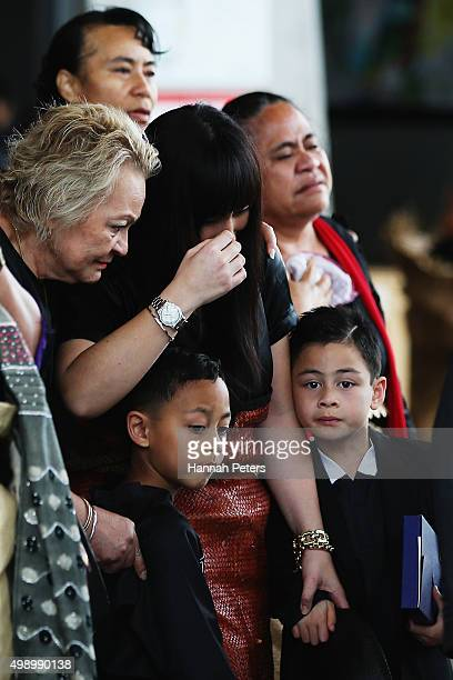 Widow of Jonah Lomu Nadene Lomu follows behind the casket carrying the body of Jonah Lomu with her mother Lois Kuiek and her two sons Brayley Lomu...