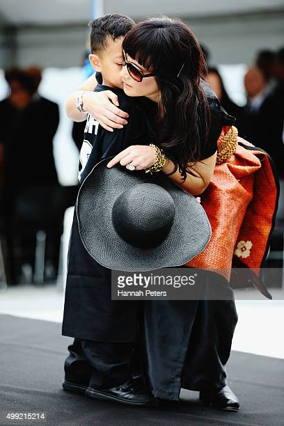 Widow of Jonah Lomu Nadene Lomu hugs her son Dhyreille Lomu at the Public Memorial for Jonah Lomu at Eden Park on November 30 2015 in Auckland New...