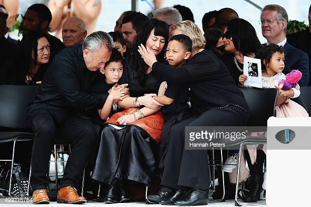 Widow of Jonah Lomu Nadene Lomu is comforted by her two sons Brayley Lomu and Dhyreille Lomu her mother Lois Kuiek and father Mervyn Kuiek during the...