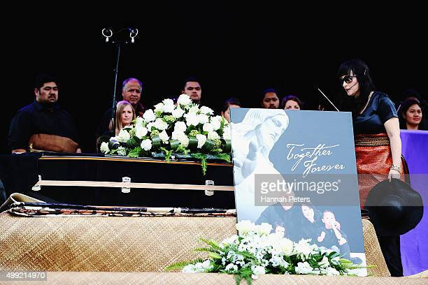 Widow of Jonah Lomu Nadene Lomu kisses a photo of her late husband on stage at the Public Memorial for Jonah Lomu at Eden Park on November 30 2015 in...