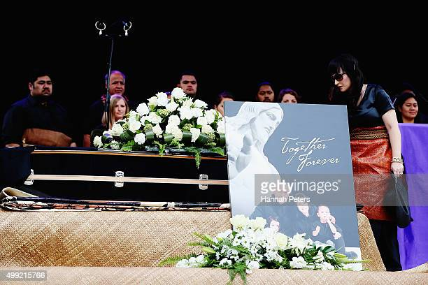 Widow of Jonah Lomu Nadene Lomu looks over the coffin of her late husband on stage at the Public Memorial for Jonah Lomu at Eden Park on November 30...
